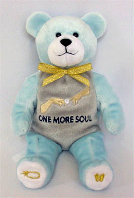 A lovable blue bear, decorated with symbols of holiness and life.